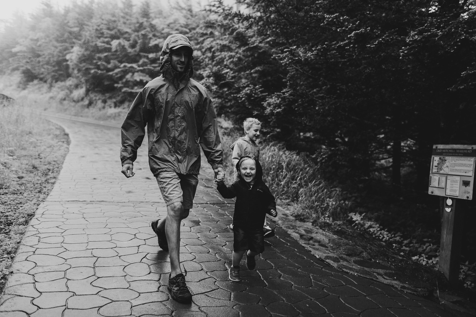 Dad and son running - Of Fate and Chaos - Family Documentary Photographer