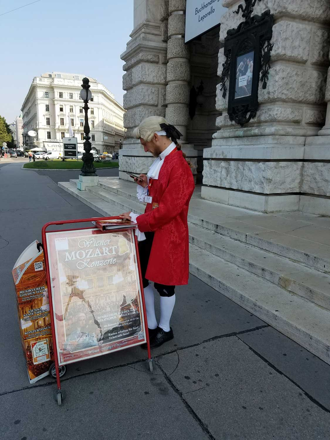 ... And Mozart sending a text message in front of Vienna's many concert halls.