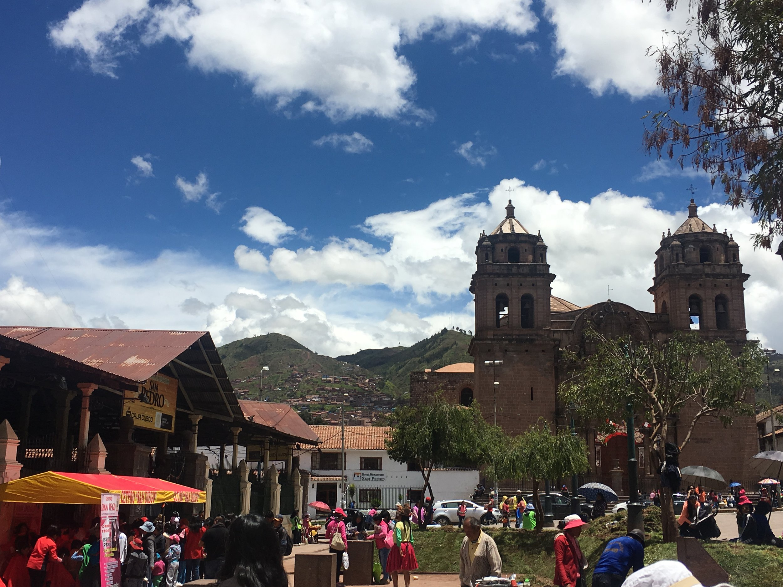 The city of Cusco with a view of San Pedro Central Market (left) and St. Peter's Church (right).
