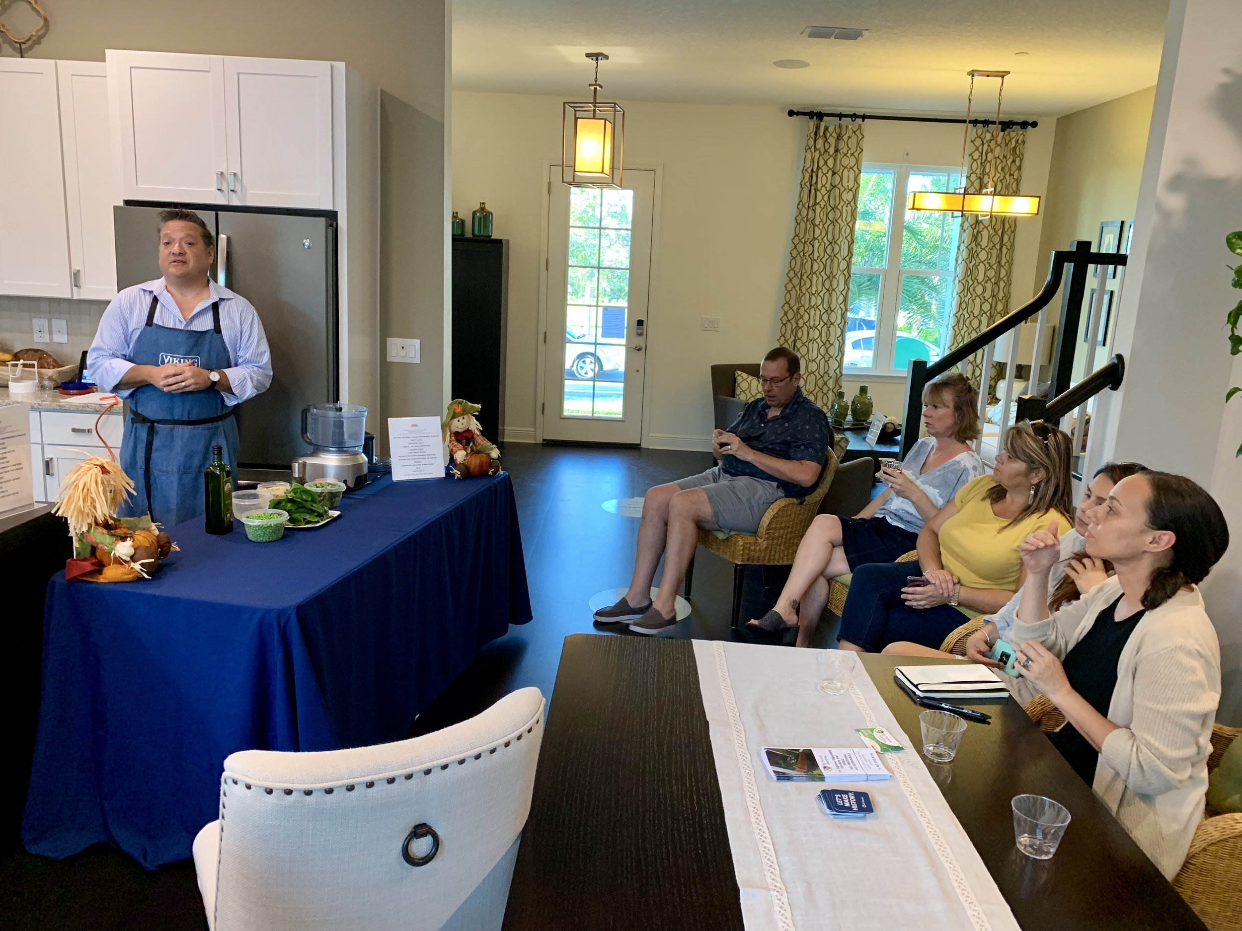 Chef Andy from Fueling Performance Athletes teaching how to prepare flavorful dishes with home-grown produce