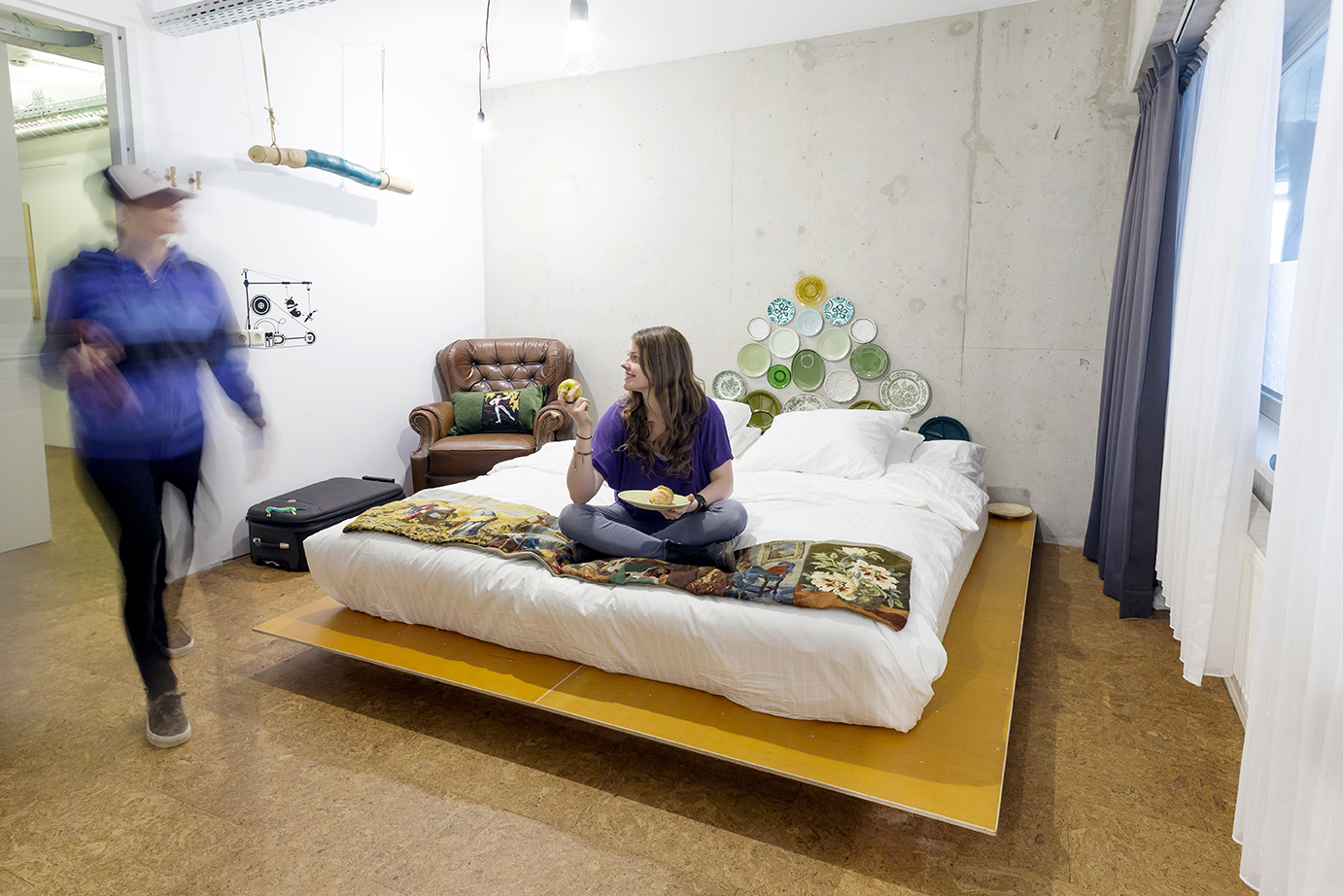 eco_room_double with girl on bed and one walking.jpg