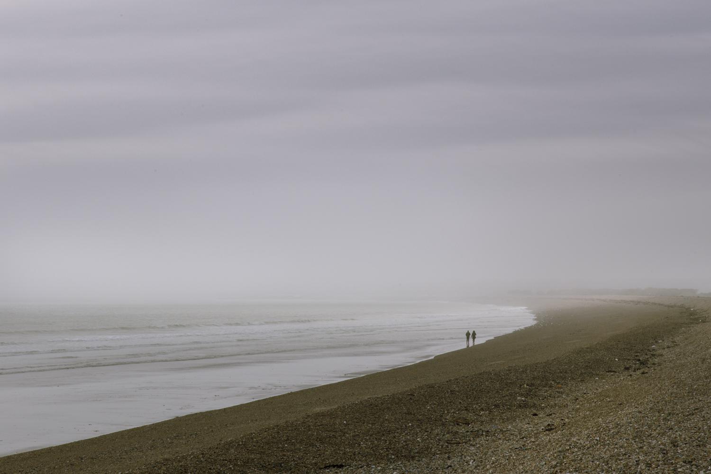 Misty beach couple