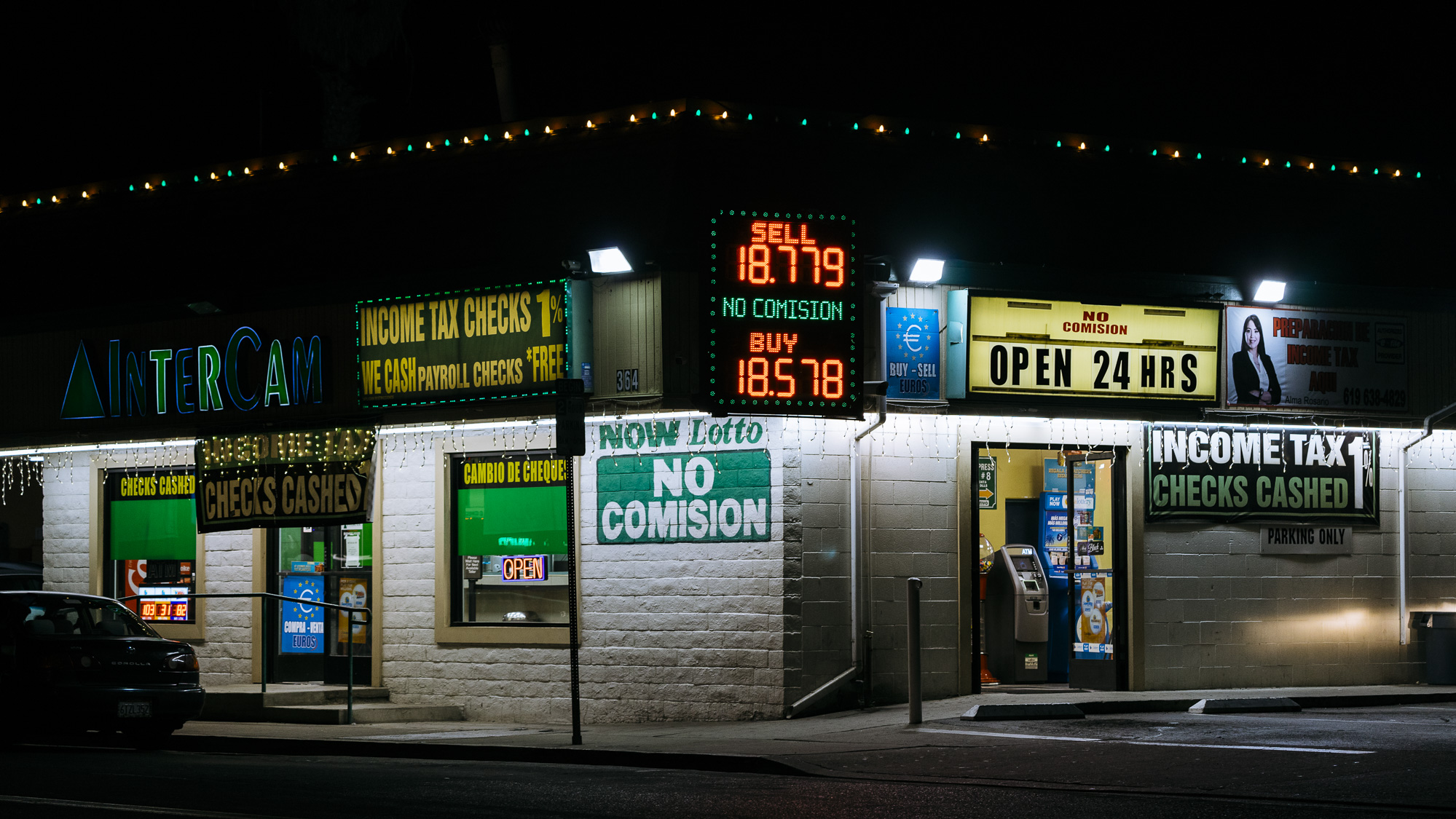 IMAGE CAPTION:  24 hour currency exchange and predatory financial services are available within walking distance of the San Ysidro Port of Entry.