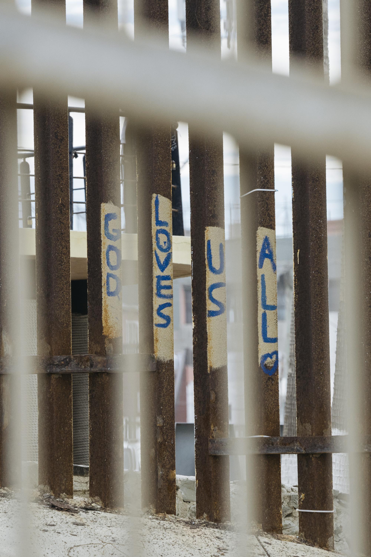 IMAGE CAPTION:  Protest graffiti along the San Diego - Tijuana border wall.
