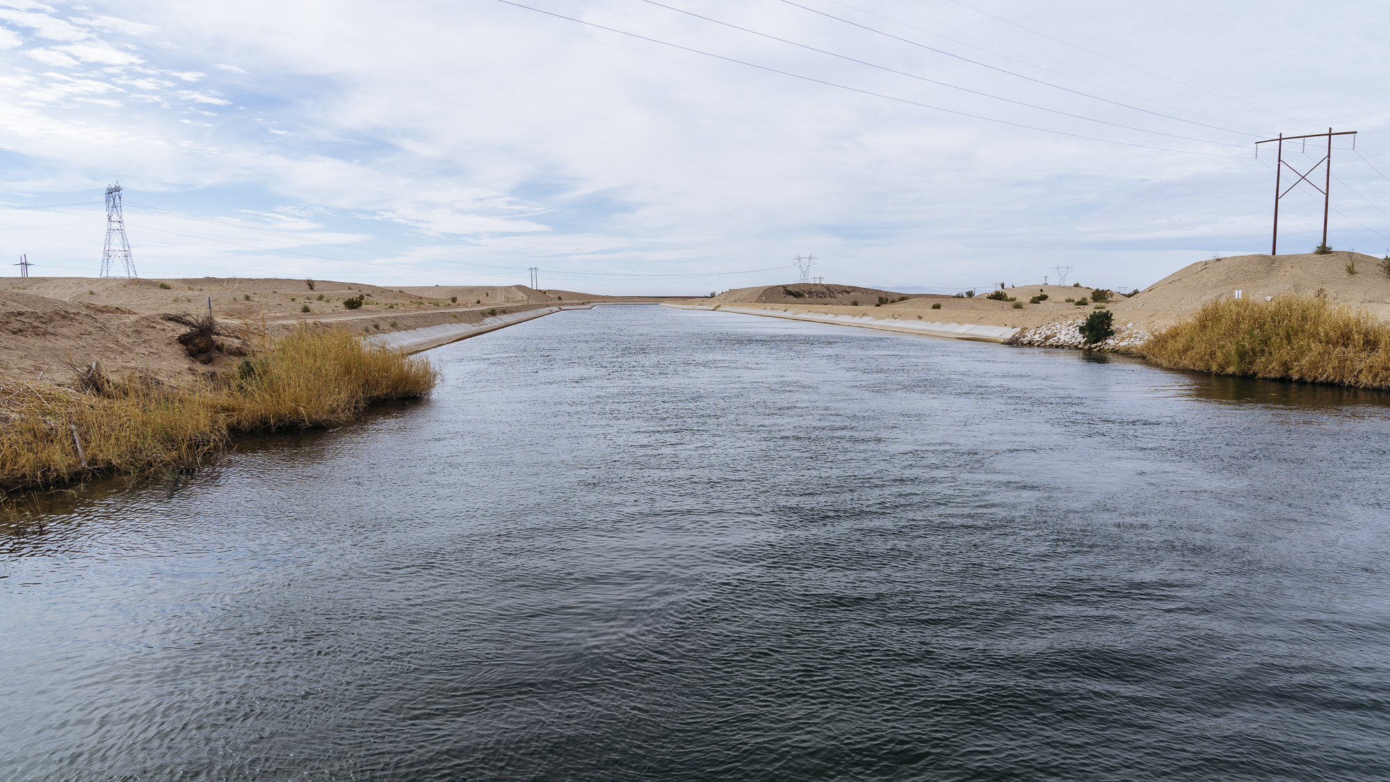 IMAGE CAPTION:  The All American Canal is America's deadliest body of water. The largest irrigation canal in the world, it serves as an effective moat for migrants as it runs alongside the border wall in Calexico, California.