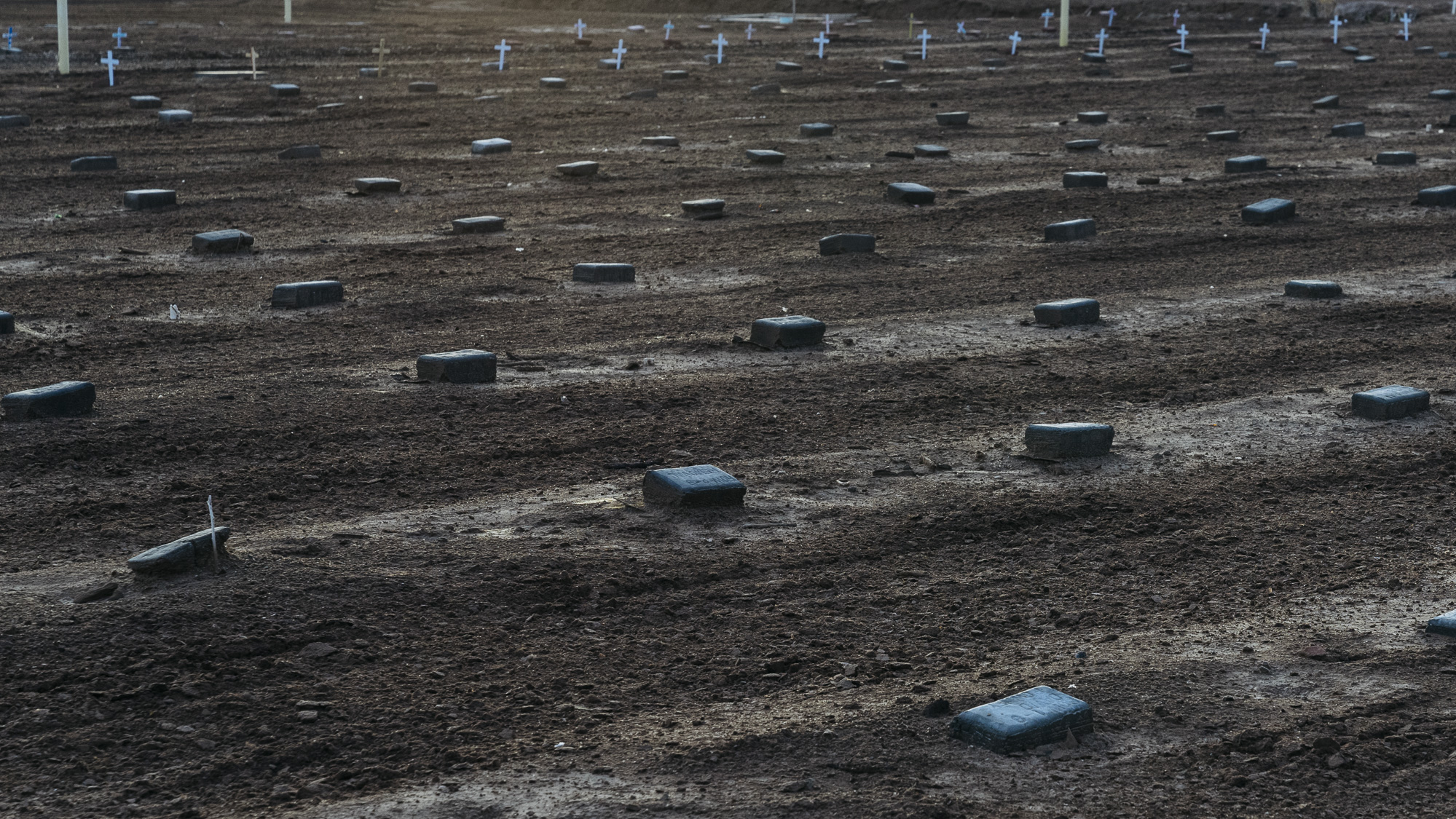 IMAGE CAPTION:  There are over 500 simply marked graves for deceased migrants in a dirt lot behind the Terrace Park Cemetery in Holtville, California. Most read Jane or John Doe.