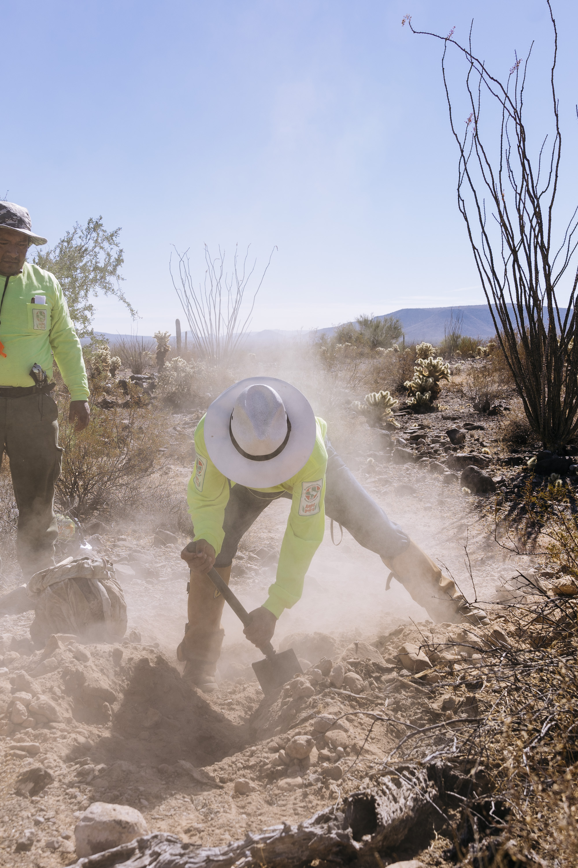 IMAGE CAPTION:  Members of Aguilas Del Desierto dig in the Sonoran Desert where they suspect the body of a migrant has been buried in a shallow grave. Most migrants who die crossing this treacherous desert have been left behind by the their guides and quickly succumb to dehydration.