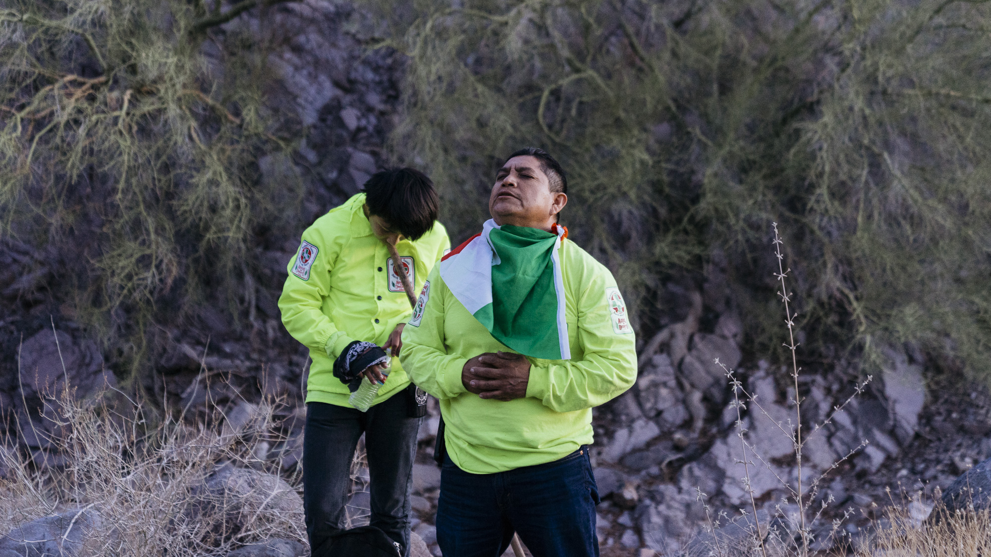 IMAGE CAPTION:  Angel Martinez (center) and 14 year old Jamie Martinez pray for their safety and the safe passage of all migrants in transit before beginning a sunrise to sunset desert search for lost and deceased migrants.