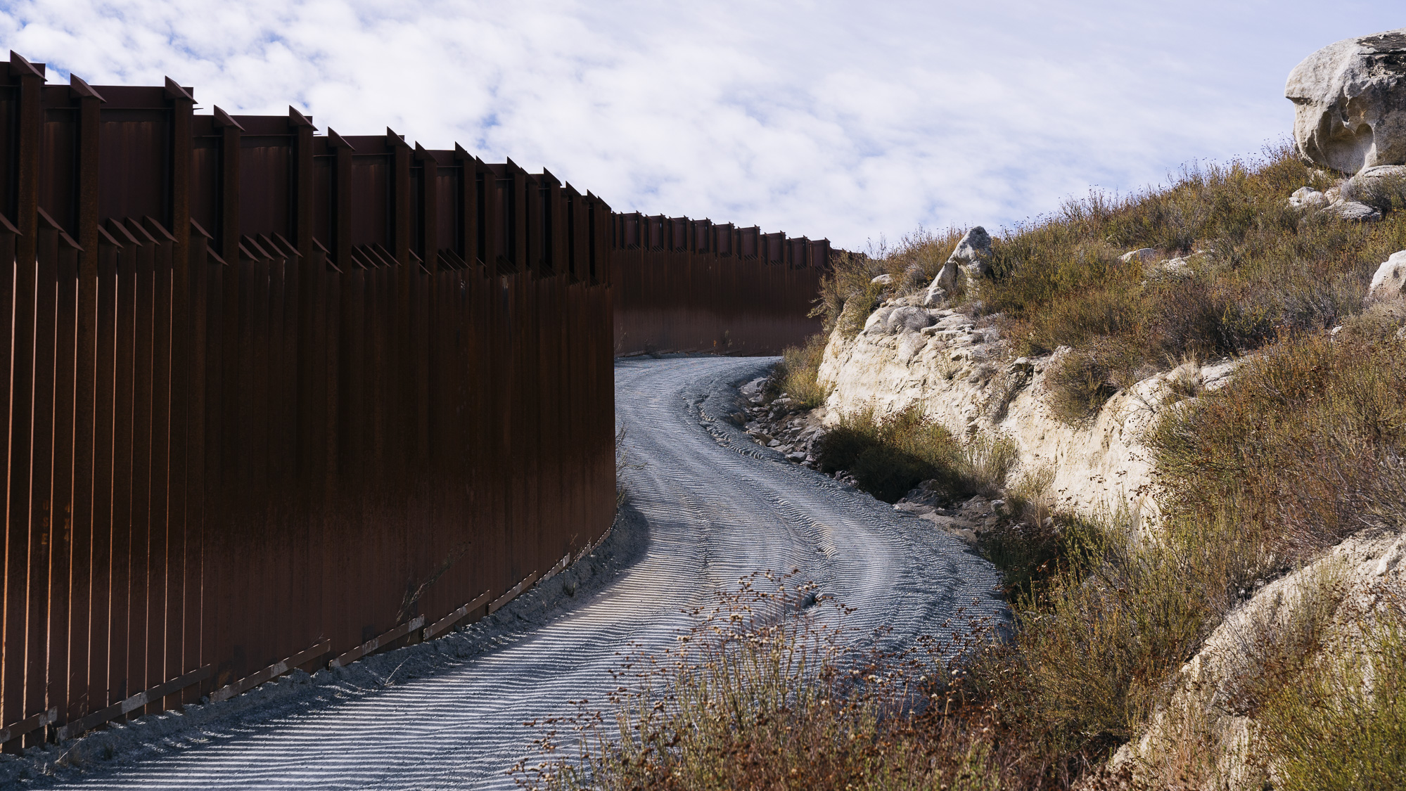 IMAGE CAPTION:   Border fence between the United Mexican States and the United States of America in Campo, California. There are nearly 700 miles of border fence already built along the 1,954 mile border between the two countries.