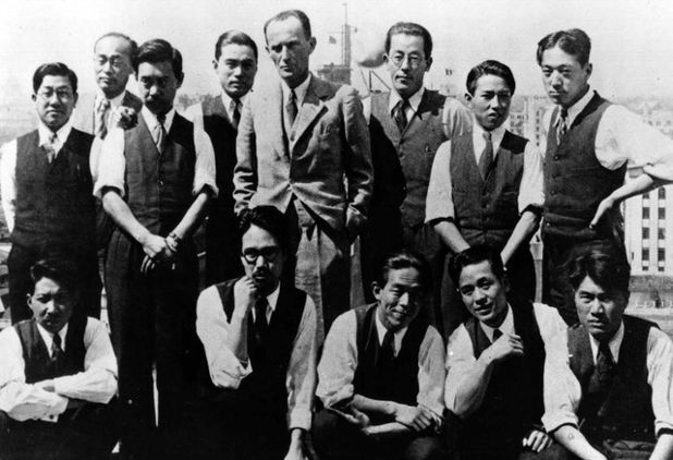 Photos of staff working at the American Architectural and Engineering Company of Tokyo. Standing in the middle is Antonin Raymond with George Nakashima to his left.-- Antonin Raymond Autobiography, 1973, Published by Tuttle