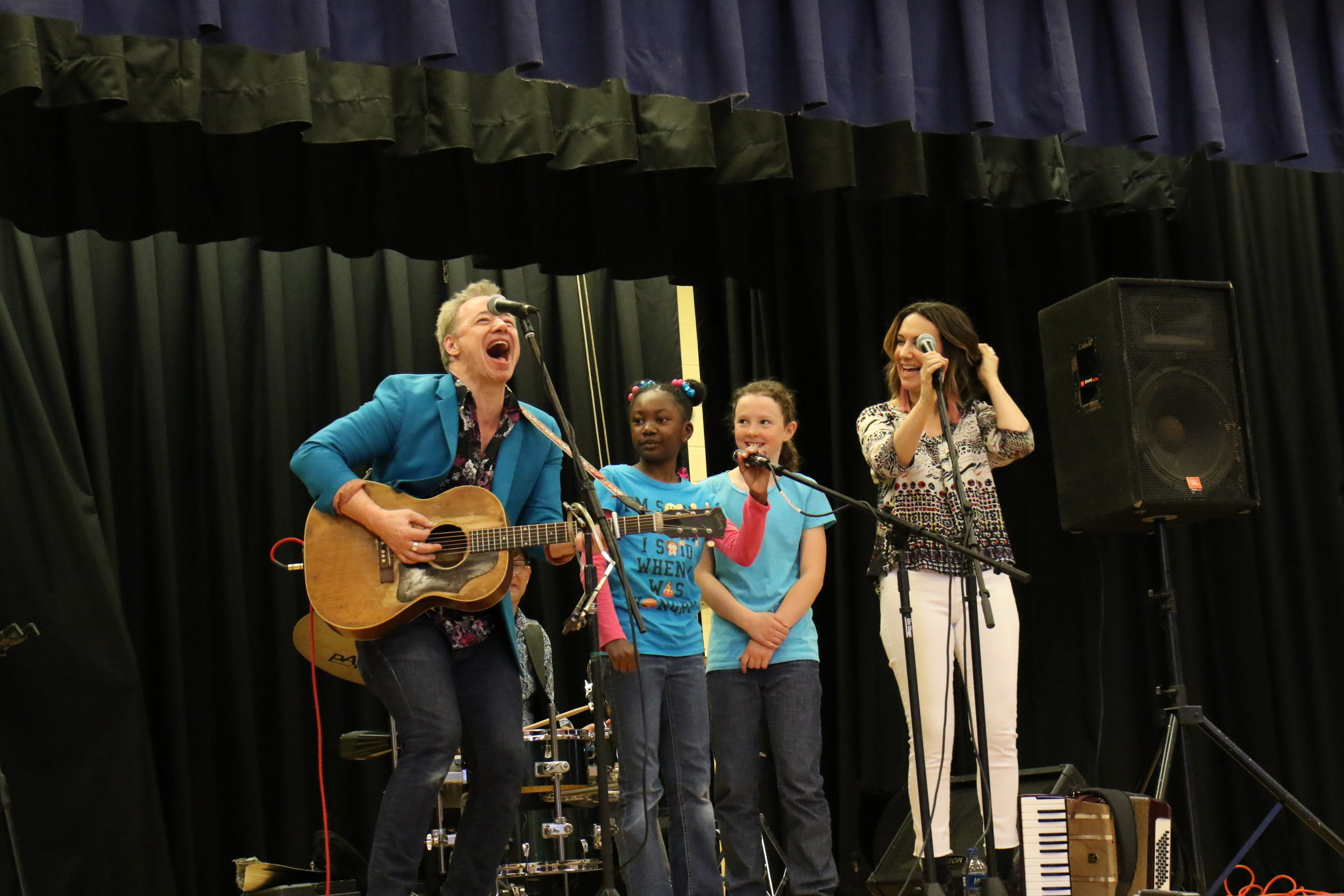 "Brady, Larry Eagle, Claudia Mussen and friends performing ""Starfish and Coffee"" at a  Love Me For Who I Am  concert at H.C. Johnson Elementary School, April 2018"