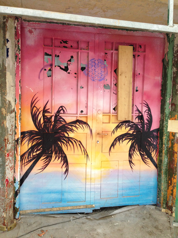 Crazy tropical double doors. Gateway to underground tiki themed disco?