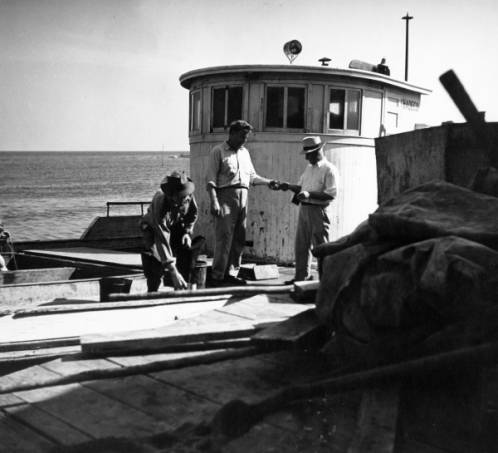 Paying Off Fisherman at Dock, Cape Hatteras 1945