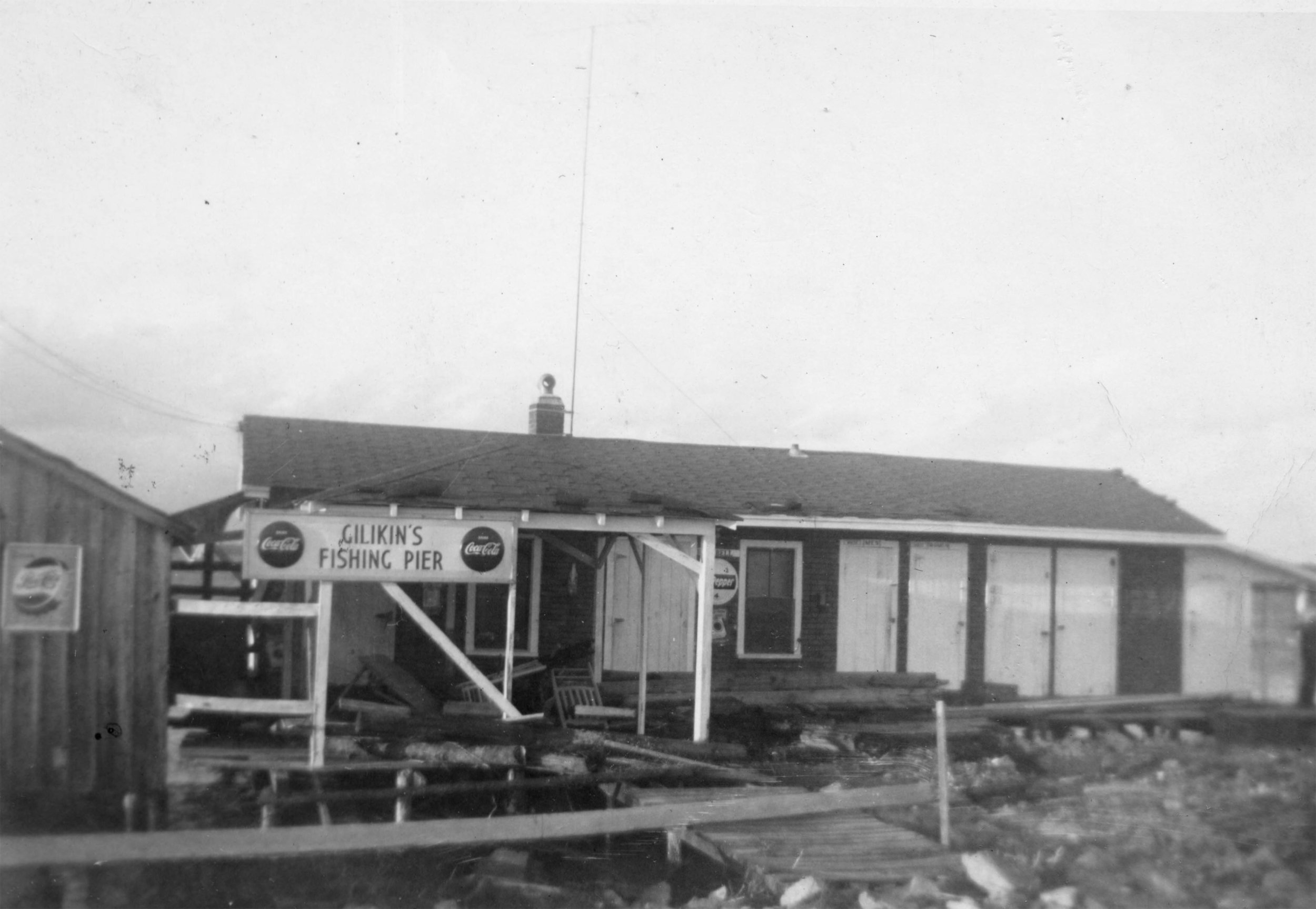 H. Gillikin's fishing pier after a hurricane, probably Hazel. Formerly located on the Bettie side of the North River bridge.