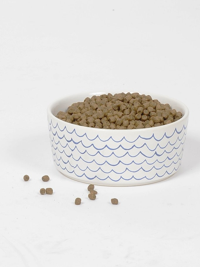 Sketched Wave Dog Bowls - Dinner is served on the high seas in this stylish dog bowl. Perfect for any nautical dog who likes to keep it classy at mealtime. Available in two sizes.