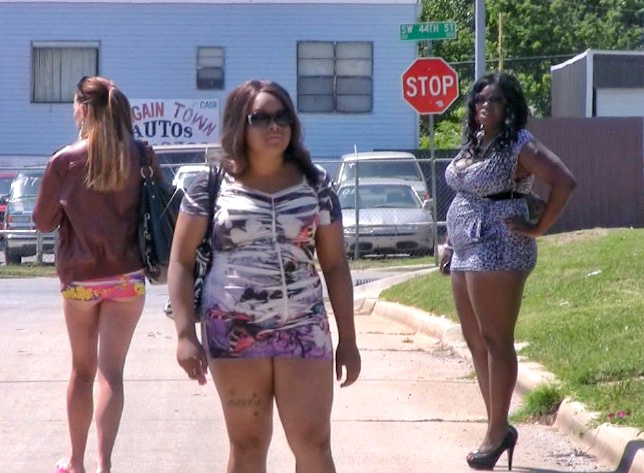 Kayla Mehler working as a street prostitute near S. Robinson Ave. in 2012.