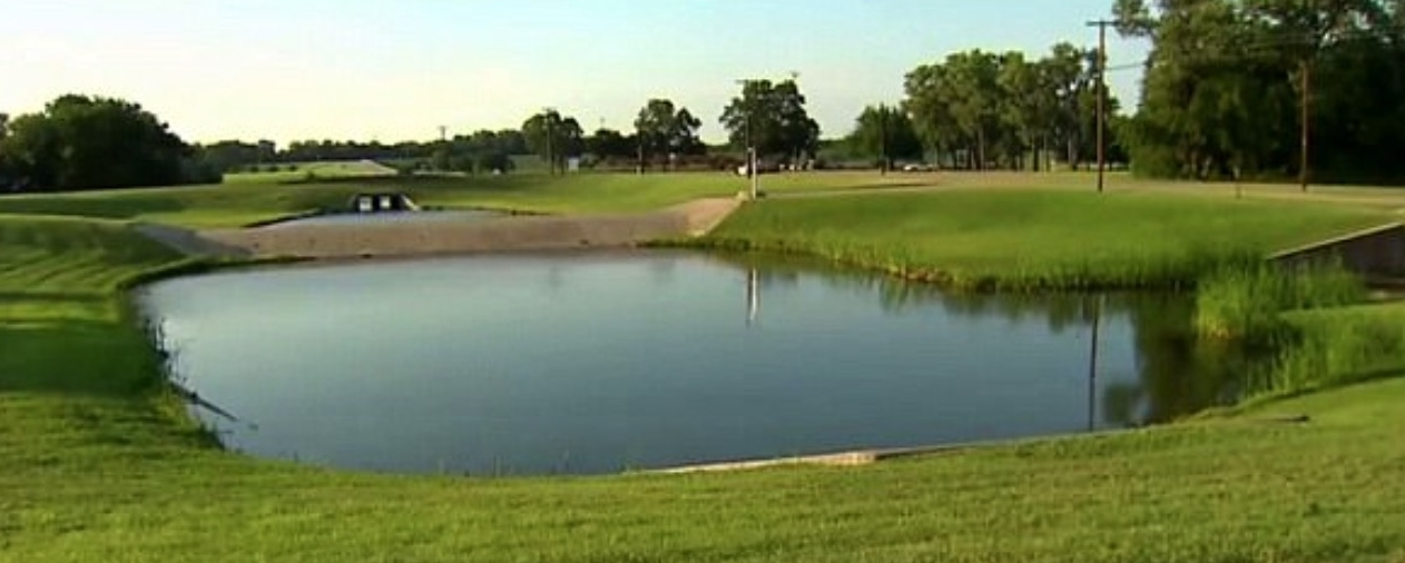 The pond at Blair Park in Dallas where Mitchell's dismembered body was found in 2017.