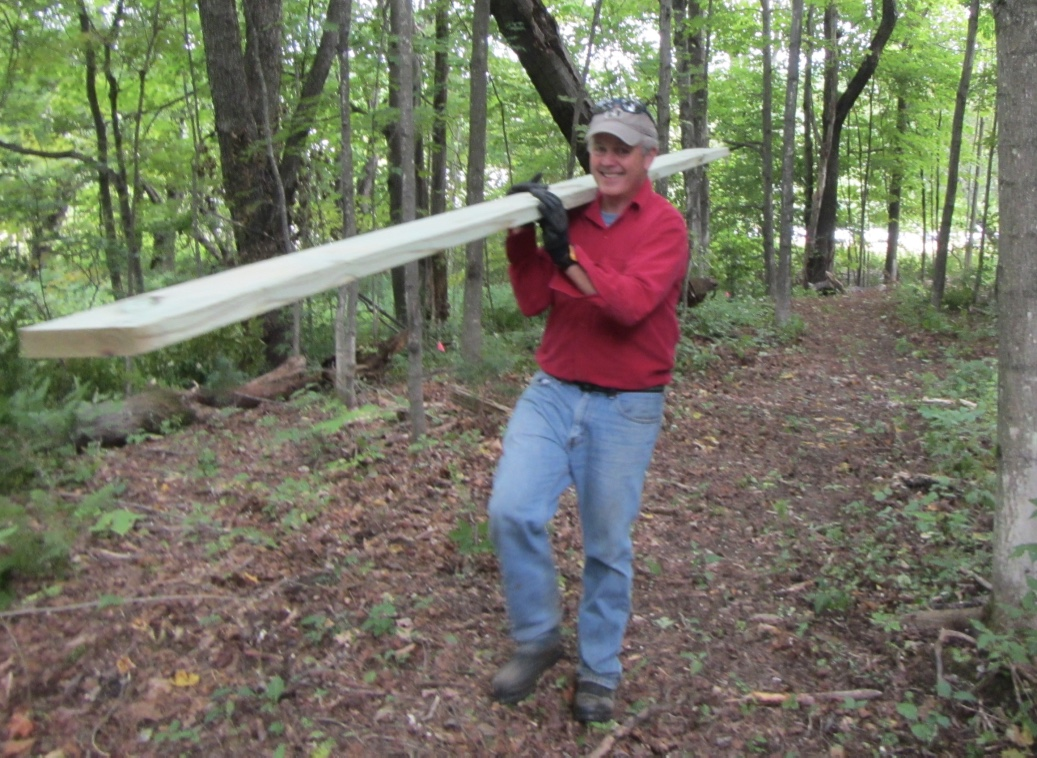 John helping to build a bridge on Wilmington's Hoot, Toot & Whistle Trail.