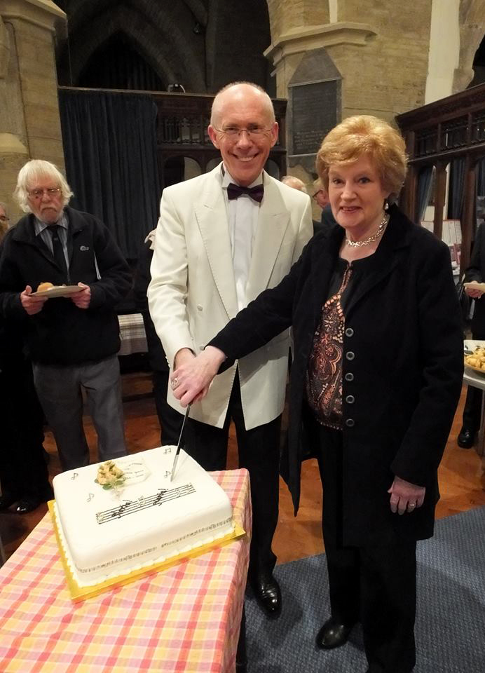 Rosemary, the choir's founder,and Christopher our director, cut the cake at the choir's 30th birthday celebrations