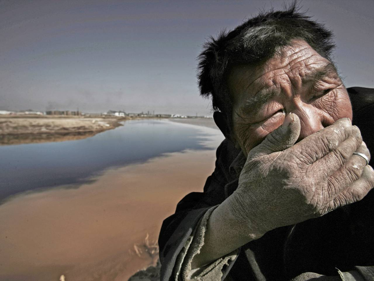 Foul-Water-Man-Covering-His-Mouth-1280x960.jpg