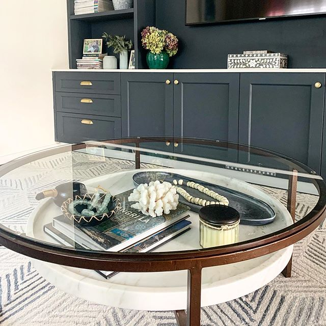 It's all in the details!  We love using a coffee table with a shelf underneath for all the things #coffeetablestyling #customcabinetry #interiordesignerbrisbane #brisbaneinteriors #dashandalbert #porchlightinteriors