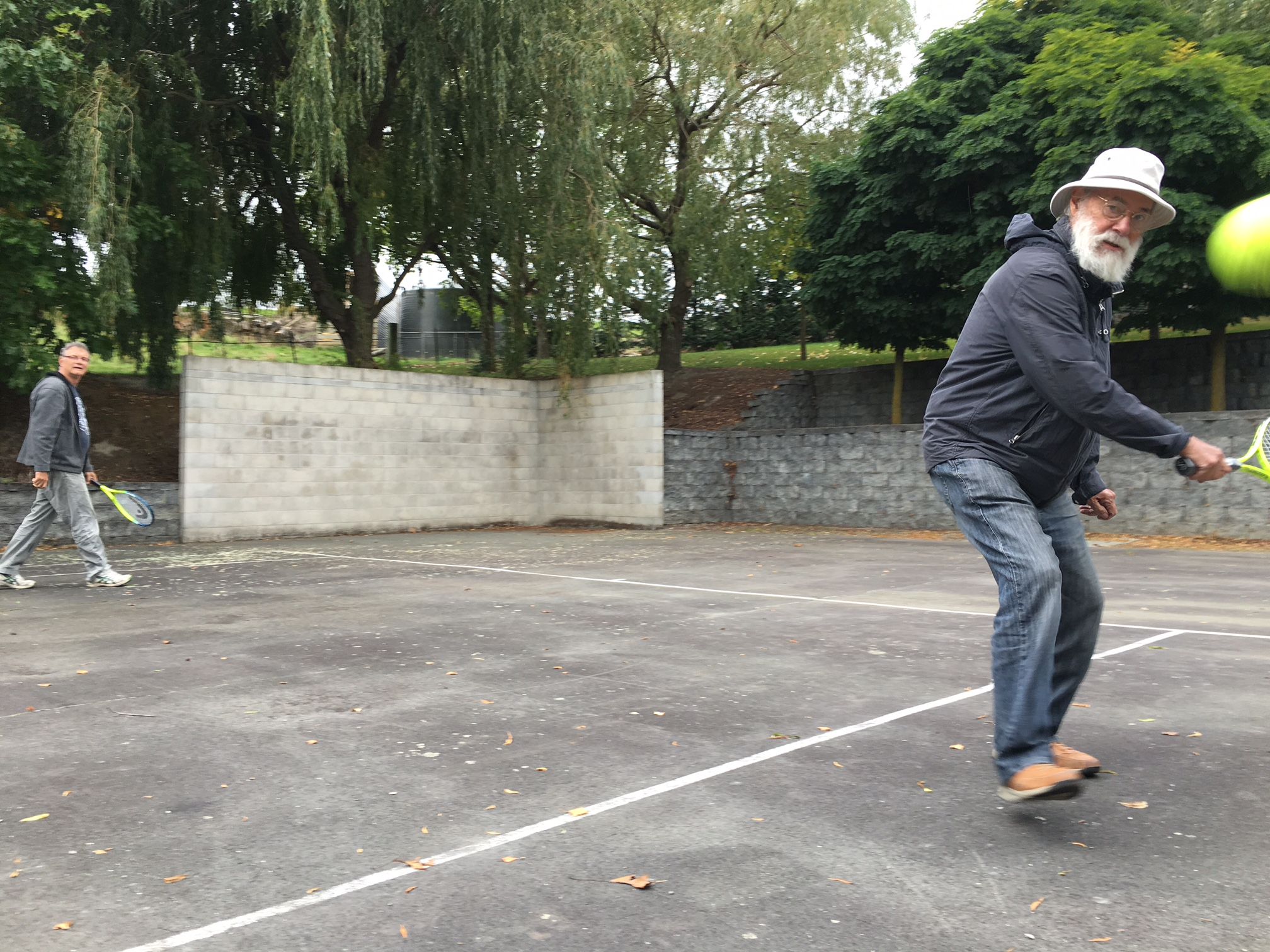 Ron Mcburnie and Kevin Connor on the tennis court at Giverny