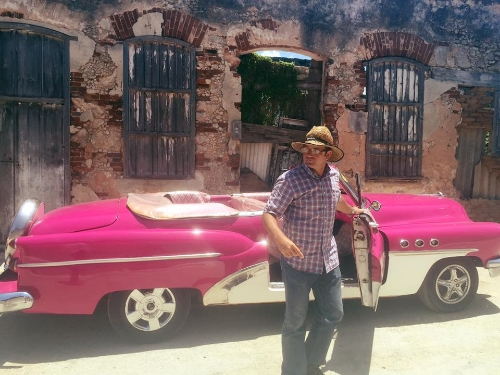 Rolando and his 1953 Hot Pink Buick.  Email him at  rol88@nauta.cu.