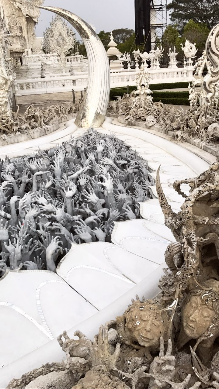 Creepy hands & heads at the White Temple in Chiang Mai