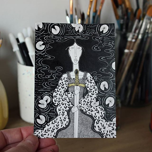 @inktober day 15 - legend. If you don't know who this 'lady' is or what this sword is called then you might want to brush up on your myths and legends. . #inktober #inktoberuk #inktoberdayseven #inktober2019 #letmetellyouastory #pininktober  #inktoberuniverse  #inktoberworld  #northeastart #womenofillustration #avalon #northeastartist #loveofthenorth #lilypads #smallindiebuisness #shopsmall #shoplocal #kingarthur #excalibur #knightsoftheroundtable #ladyofthelake #mythsandlegeneds #onceandfutureking #thelegendofkingarthur #medieval #swordandthestone #arthurianlegend #goldink