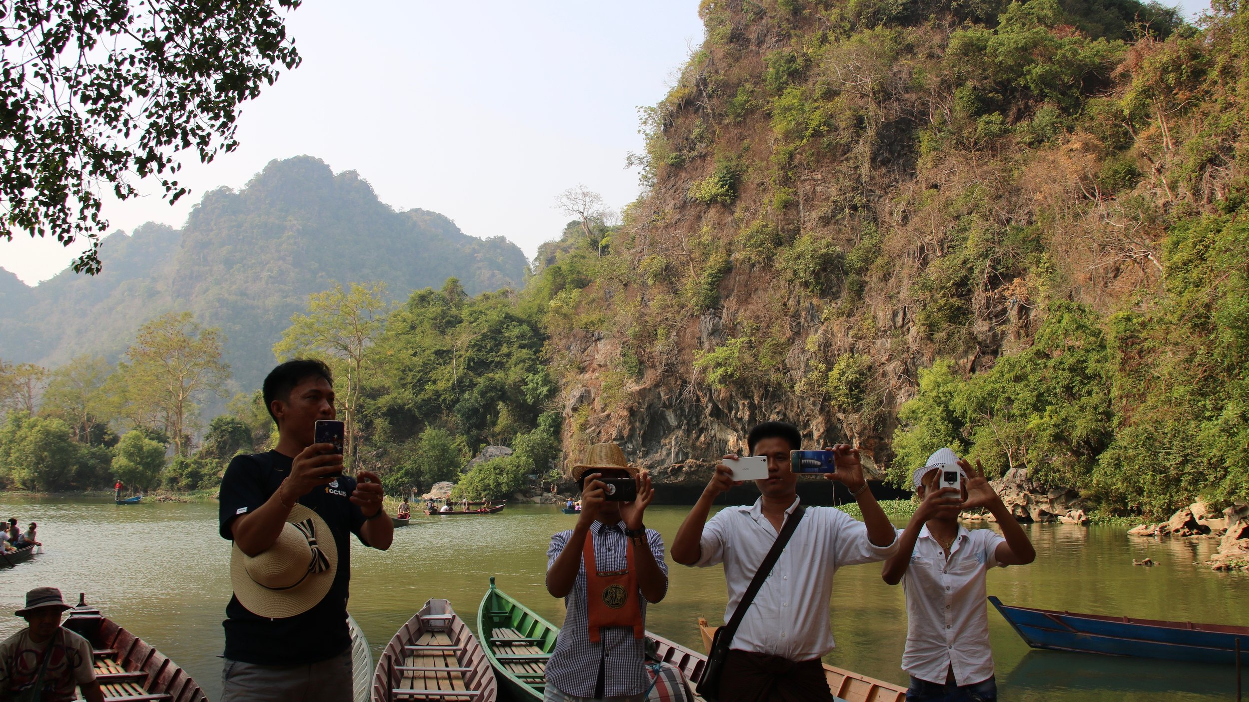 Myth-busting Myanmar: thirteen misconceptions and the truth behind them. Locals taking photographs of tourists