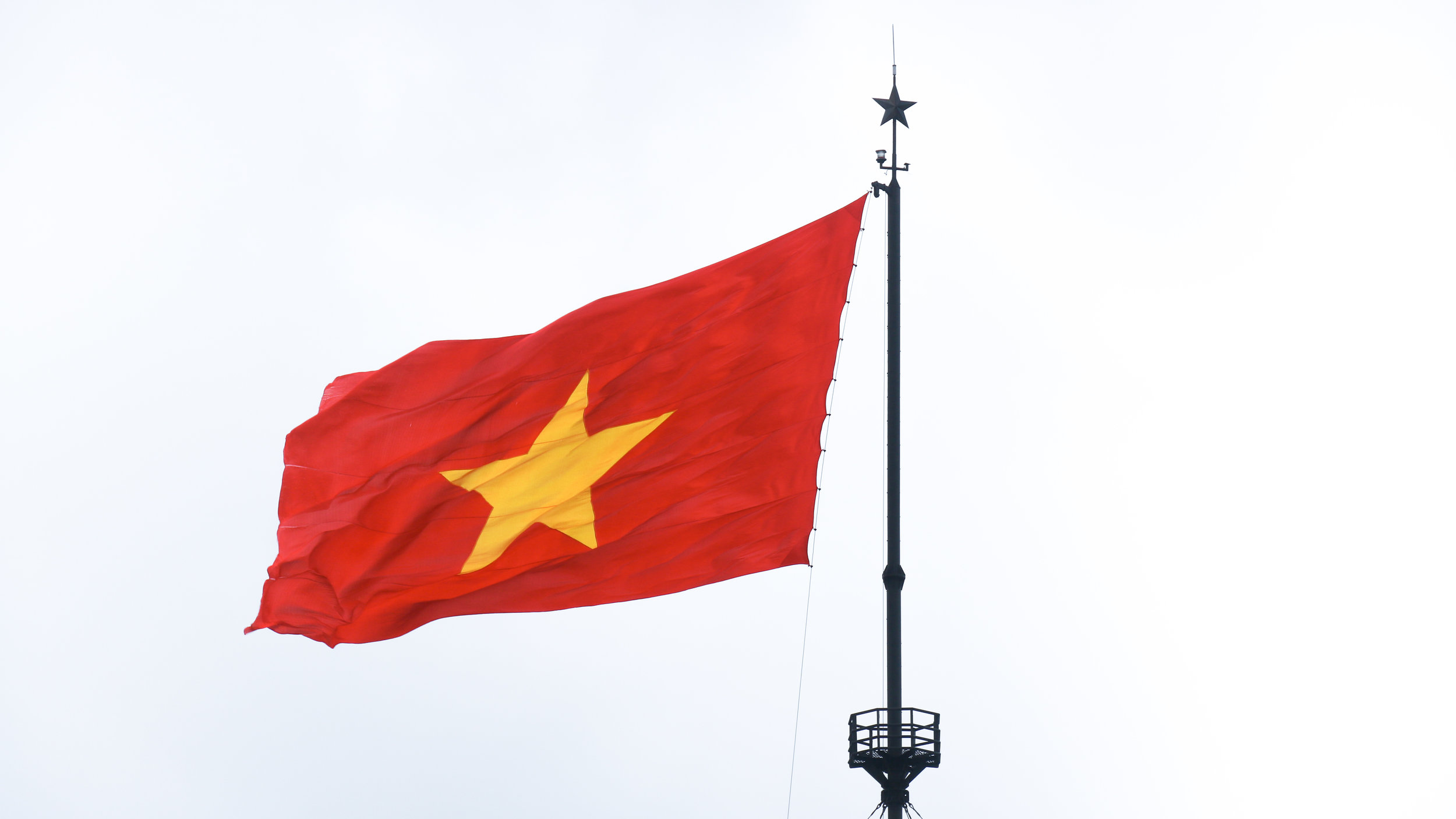 Vietnam flag, 15 really useful things to know before travelling to Vietnam, Across Land & Sea