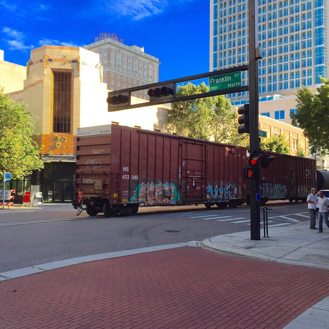 "Apparently in Tampa, freight trains share the road with cars and pedestrians. I felt like I was in ""Inception"". (at Tampa, Florida)"