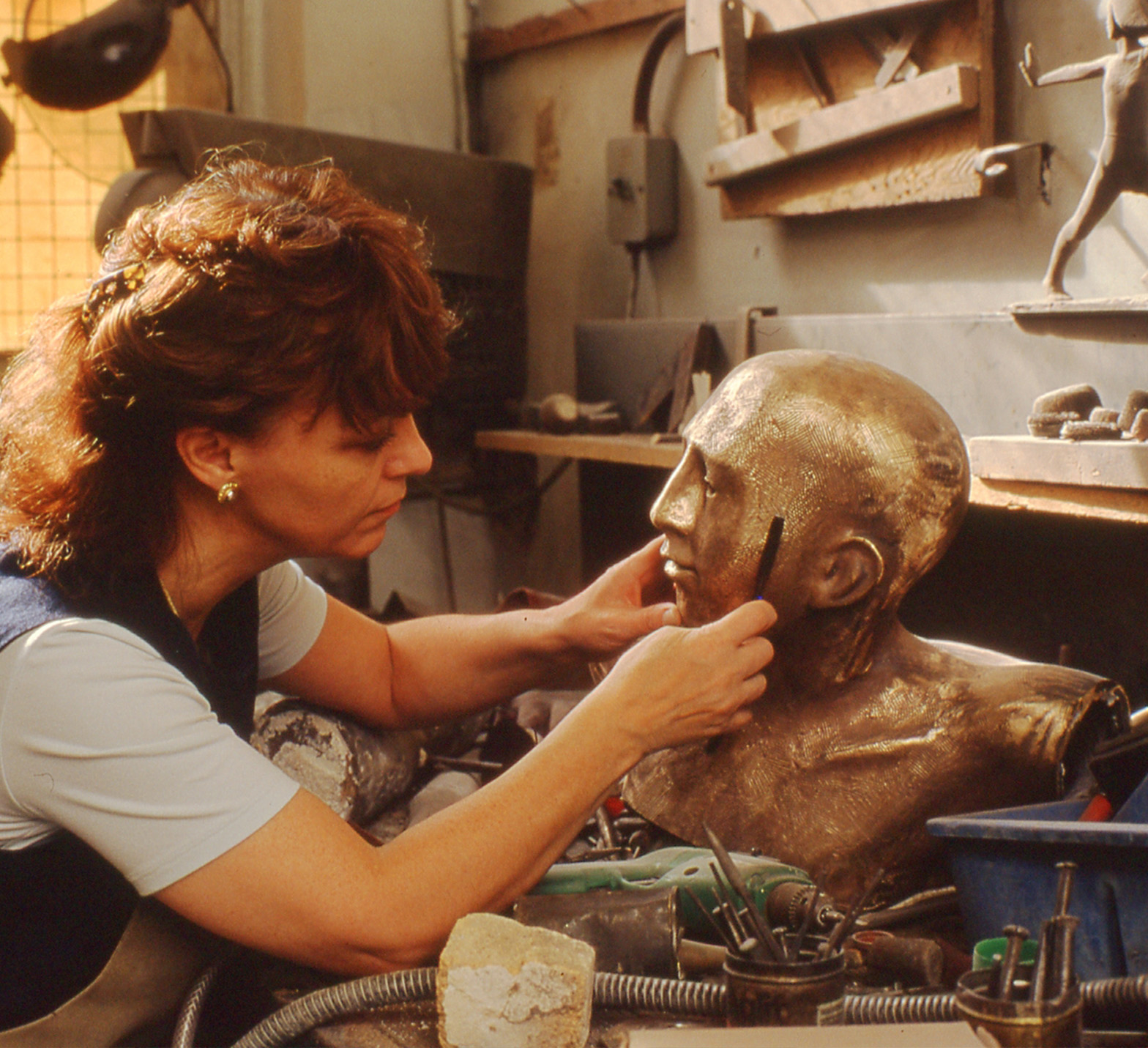 "Philomena working on a sculpture in bronze titled ""Fairway"" commissioned by Sir Peter Michael CBE for Donnington Valley Hotel & Golf Course, Newbury, UK."