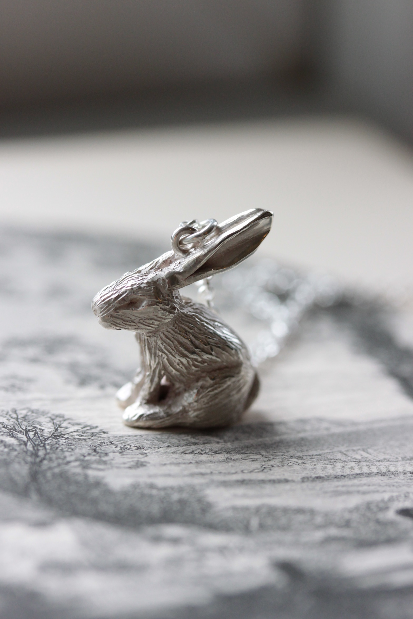 Our tiny rabbit necklace in sterling silver.