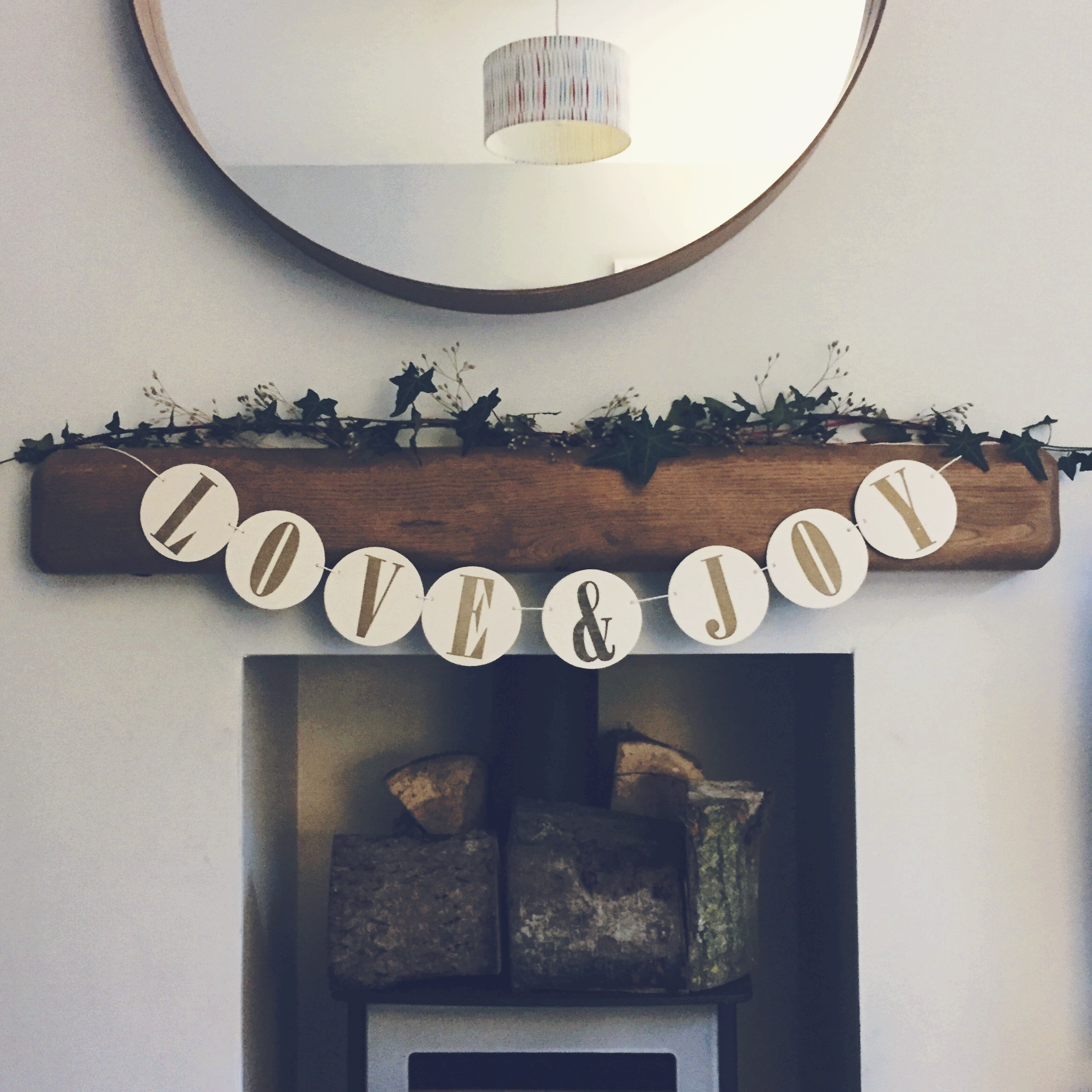 Ivy and dried wildflowers collected from the woods made a festive garland for our fireplace.