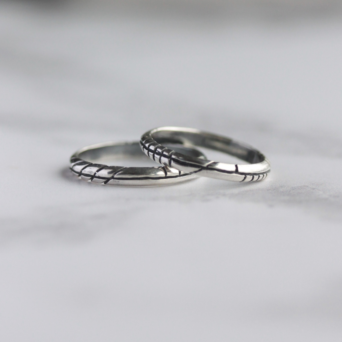 A set of silver rings, etched with Ogham lines, an ancient Irish alphabet.