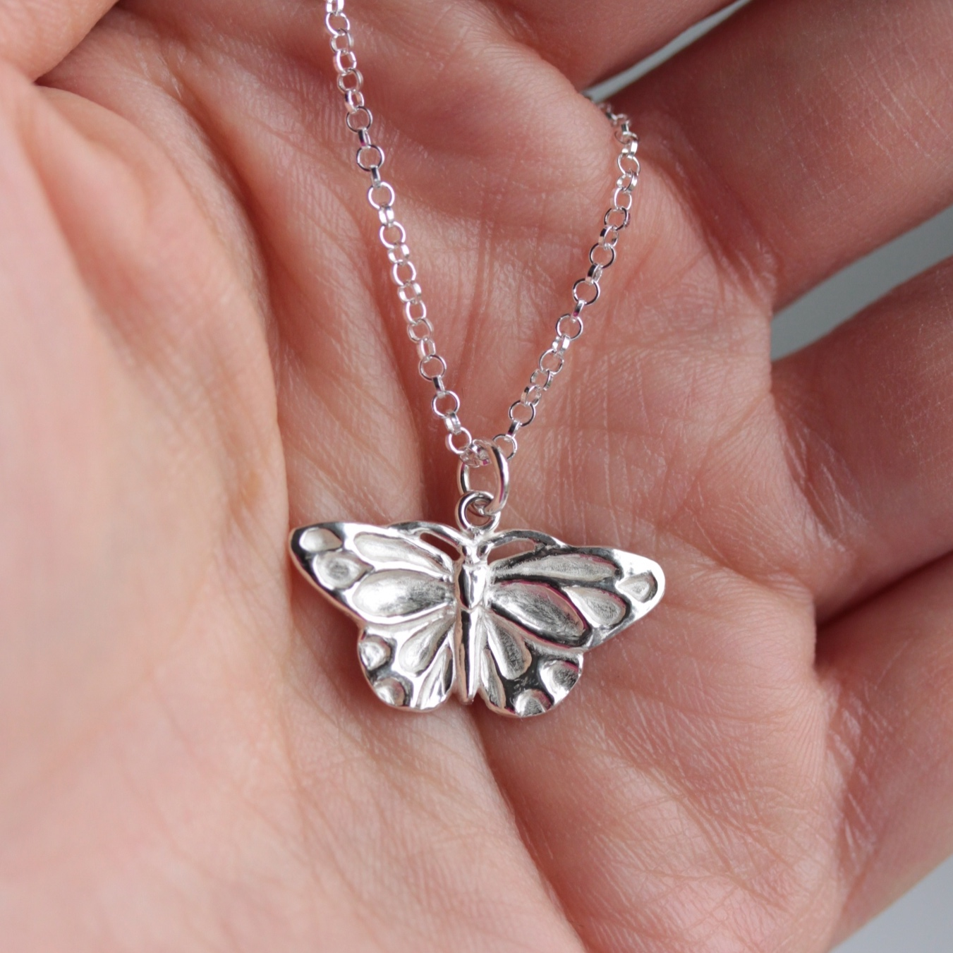 A delicate butterfly necklace was created for our client to symbolise the birth of their baby Granddaughter.