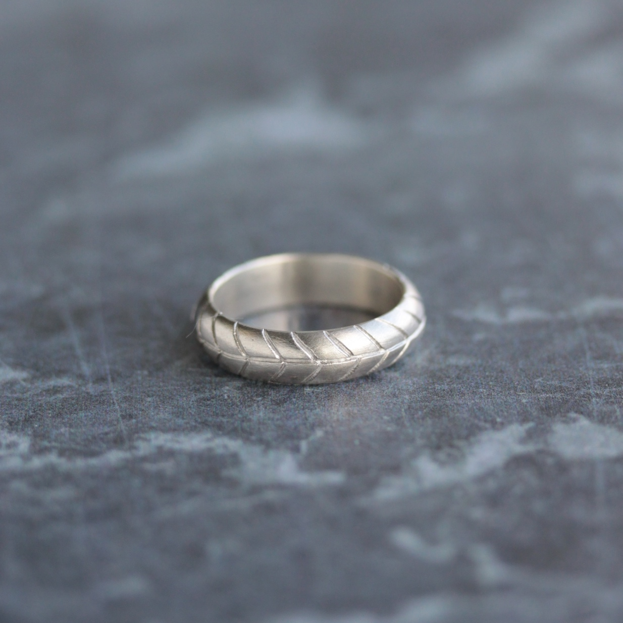 A wedding band created for our client inspired by the wheat motif that also features on his wife's wedding and enagagement ring.