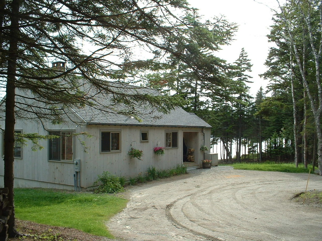 With the ocean a stone's skip away, this main house serves as the gathering spot for the many bunk cabins that are located along the water's edge, allowing friends and family to enjoy the many splendors of this property.