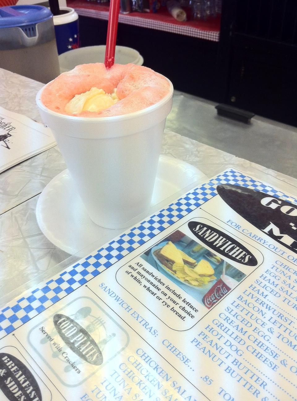 A strawberry soda (strawberry syrup, soda water and vanilla ice cream) from Goolrick's
