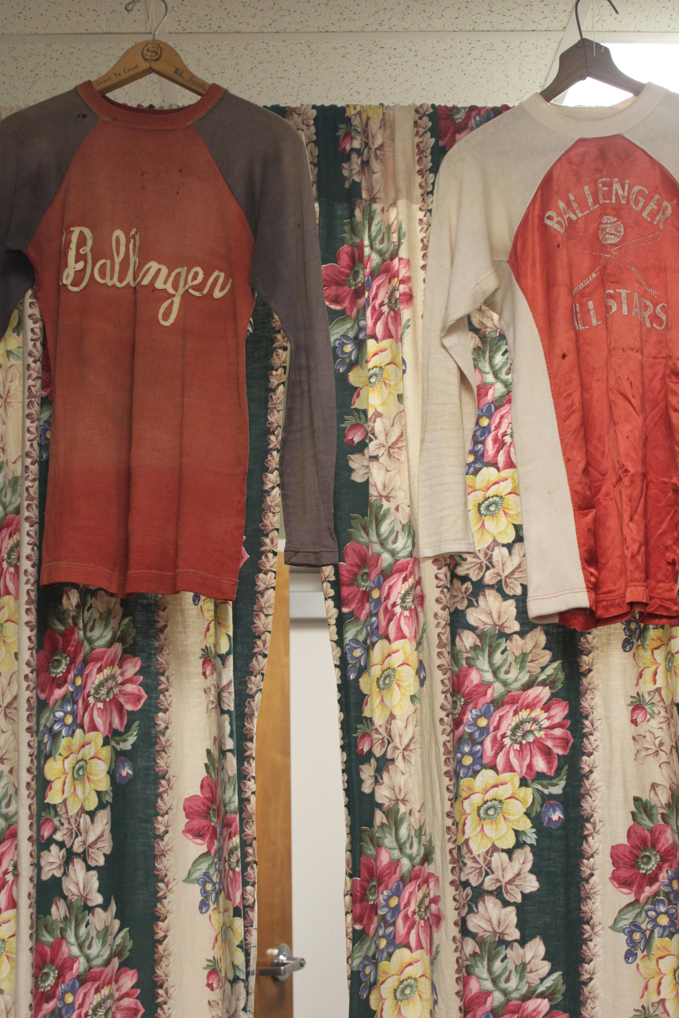 These tops look right at home hanging in front of a floral fabric backdrop.