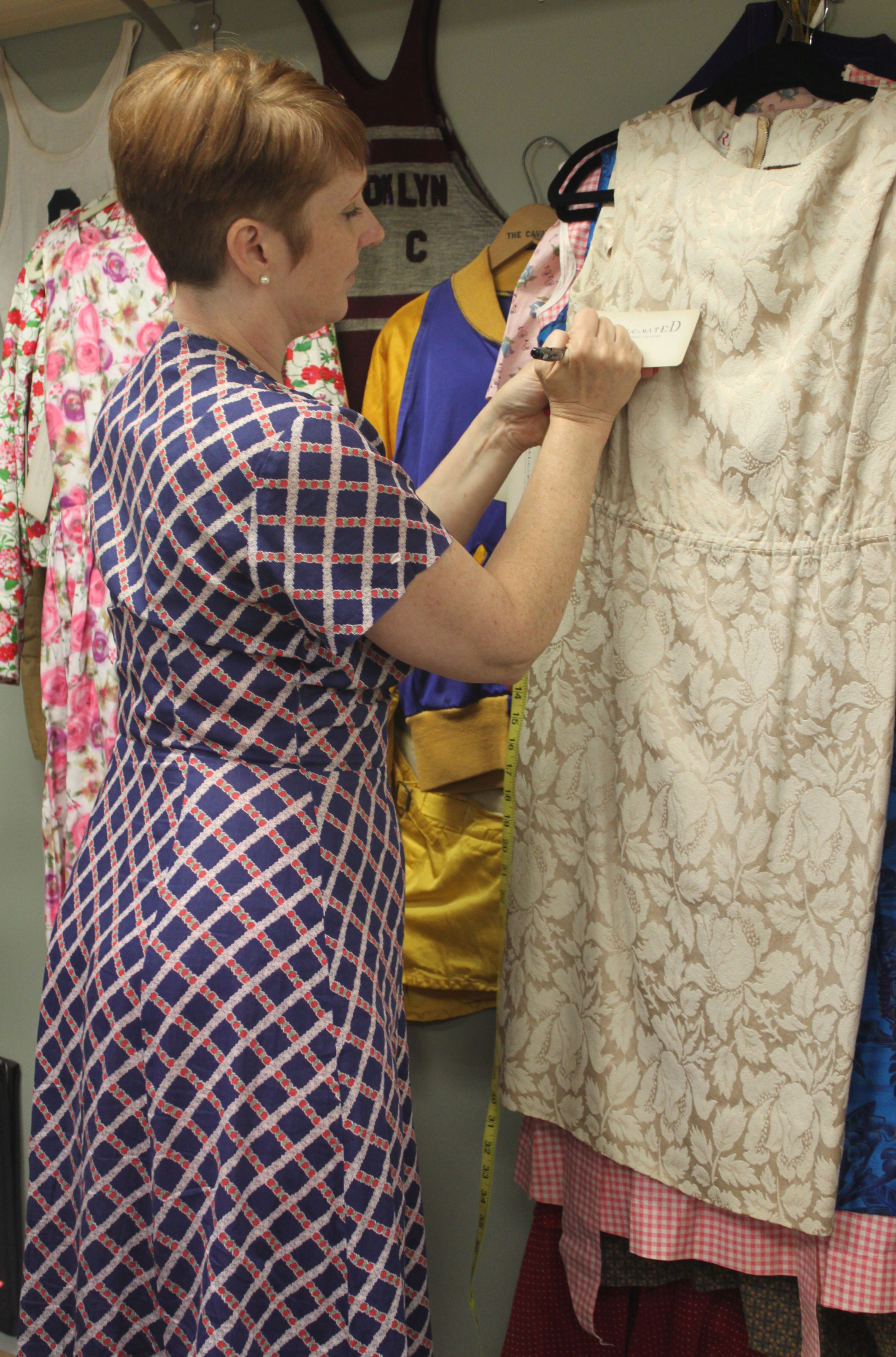 That's Shelley, sporting a lovely vintage dress of her own, pricing a pretty 1960s number.