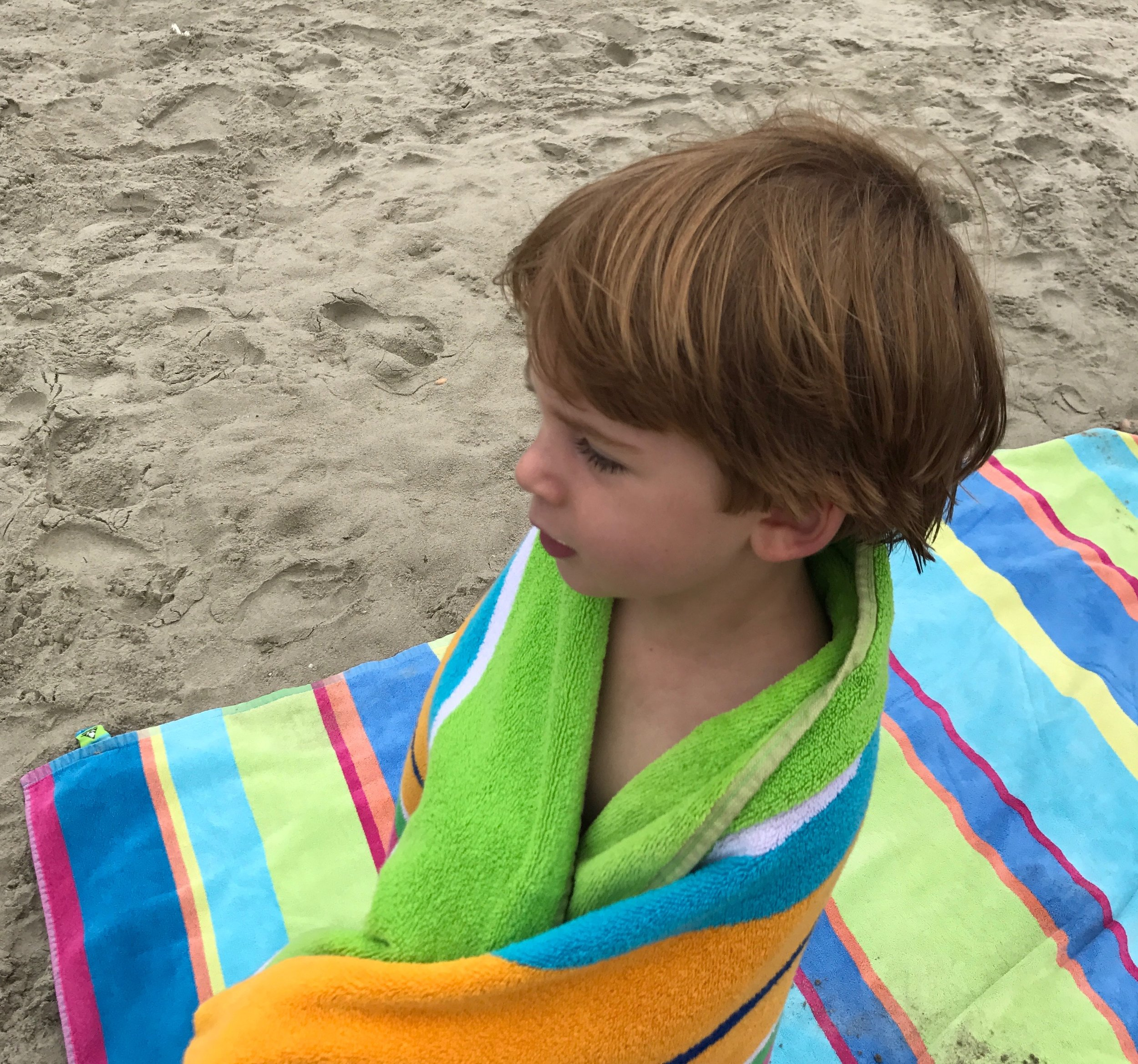 The kids took turns bundling in towels during breaks. This is Lloyd and Jennie's oldest, Harris.
