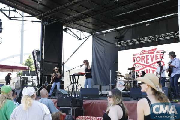 Lari and band CMA Fest's Forever Country stage 2017