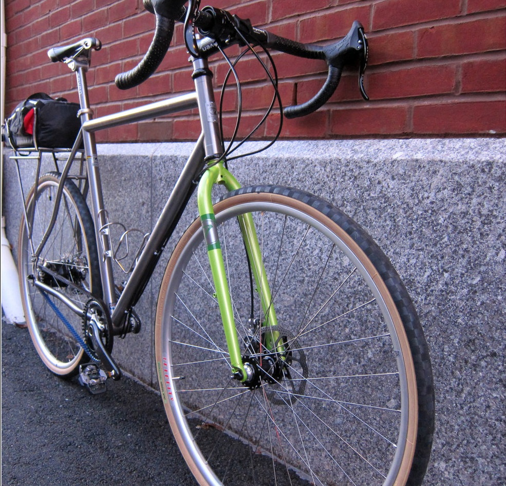 This Seven ExPat has a custom steel fork, Rohloff hub with belt drive and a lightweight rear rack. After this photo was taken, the bike received a generator light and hub to make it even more long-distance worthy. Note that a PBP-specific bike will have different design and component choices made. Bikes great for touring or for shorter randonneuring rides will look a little different than the ideal PBP bike. This bike, for example, shows off a lot of great features and functionality options, but wasn't designed for PBP.