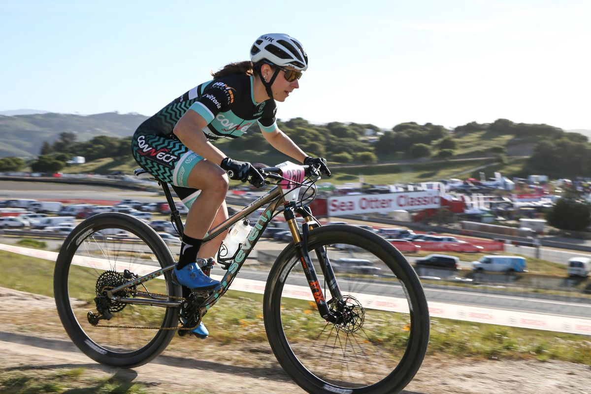 Kelly Catale races at the highest levels across the U.S. and finishes on the top of the podium in New England mountain bike races. Here she's flying on her Seven Cycles KellCat at the Sea Otter Classic.