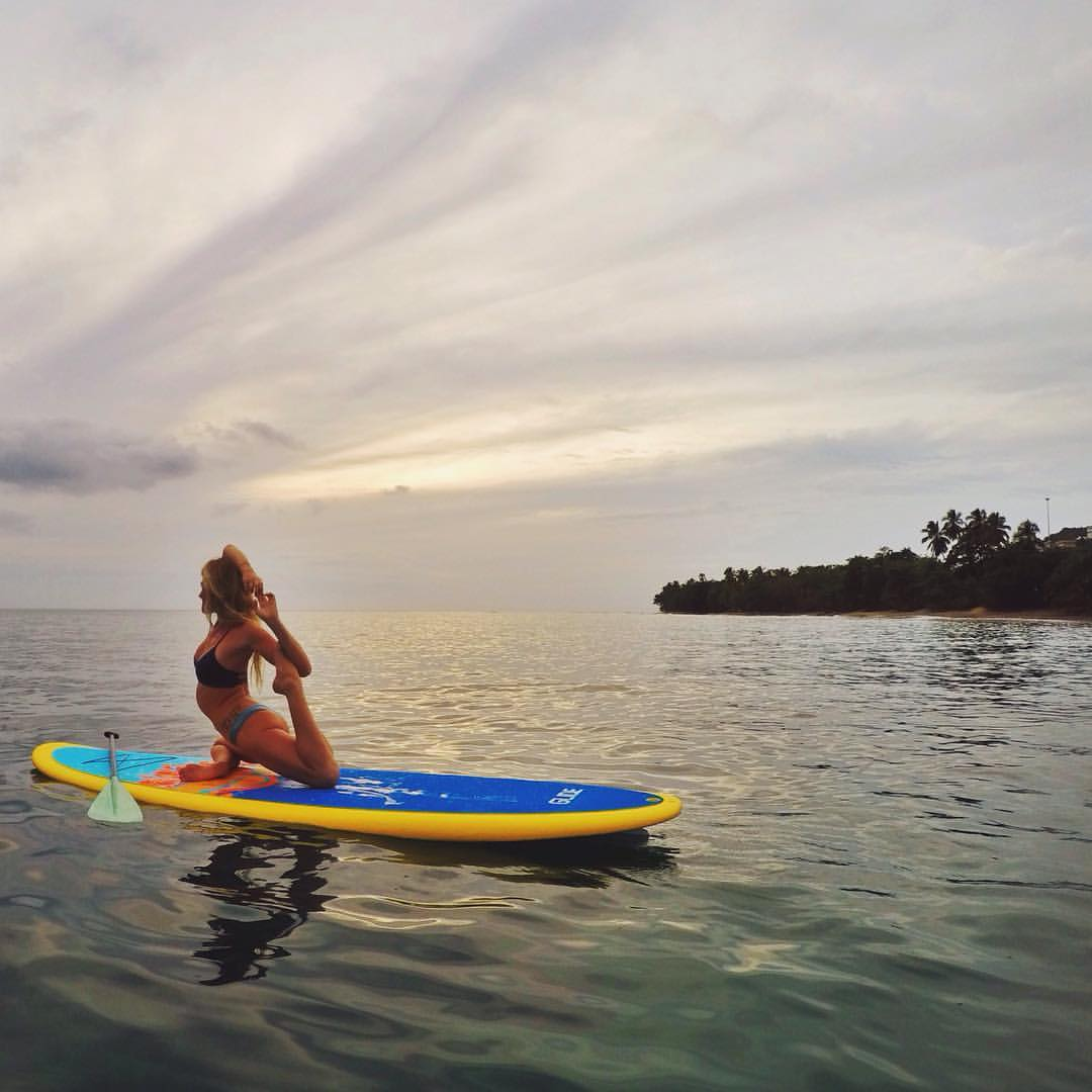 Enjoying a lovely stretch on my Glide Lotus SUP Yoga Board