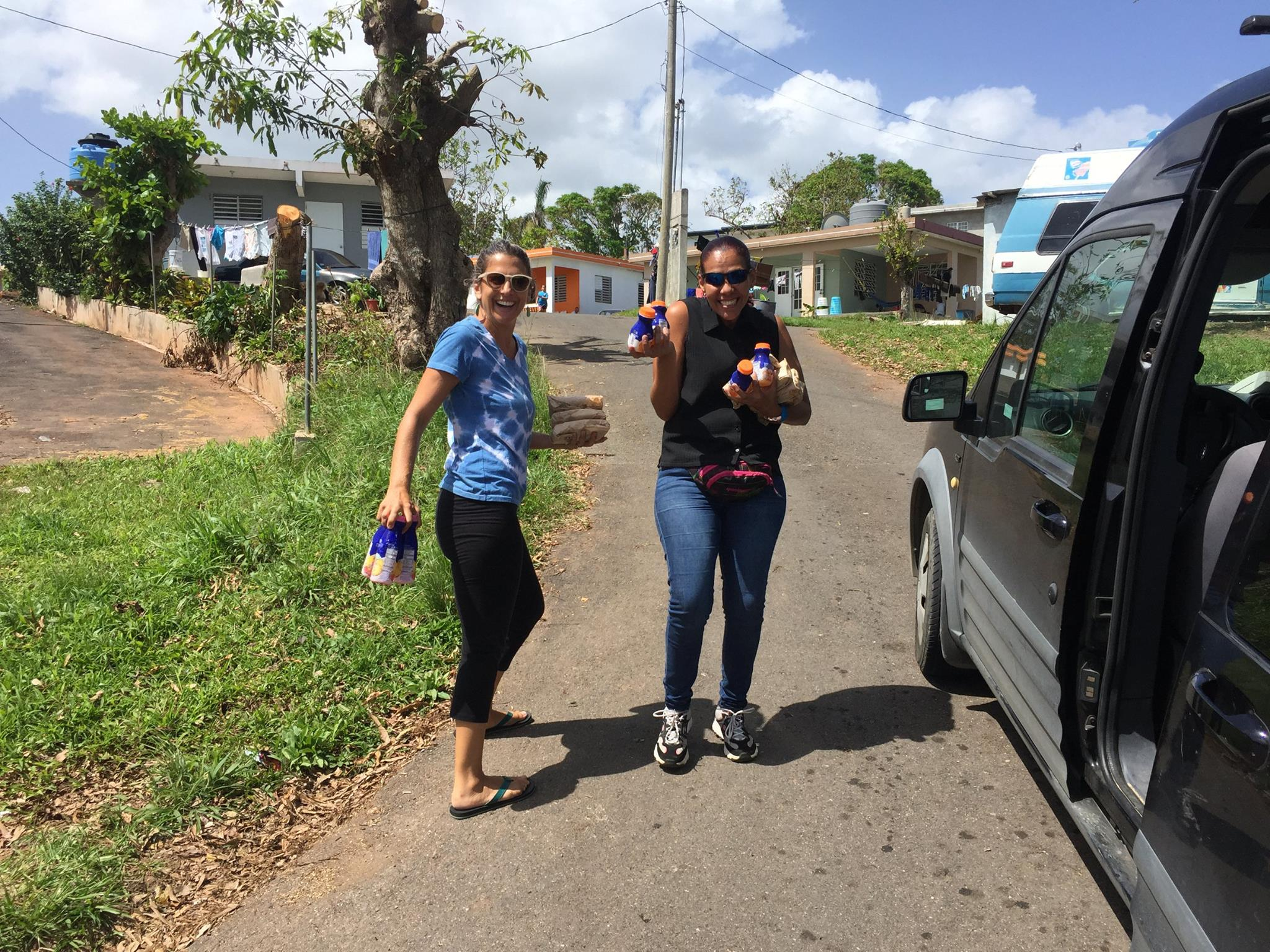 Vivienne Miranda + friend bringing food and drinks to neighborhoods in Anasco that have received no aid.