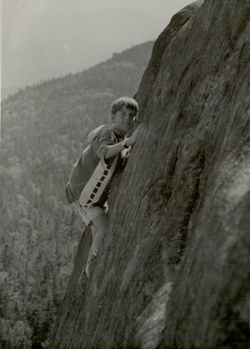 The author on the summit of Ampersand Mt in July of 1991 (This is a well constructed photo, the ground was literally inches beyond the bottom of the frame.)  Photo by Harry Sauerhafer
