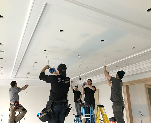 Close to 270 pot lights in this house means all hands on deck to get a jump on finishing.  ___ #torontoelectricians #electricians #electricalcontractor #electrical #newbuild #torontobuilds #customhome #torontocustomhomes #torontohomes #renovator #torontorenovation #potlights #contractorsofinsta #buildersofig #electriciansofinstagram